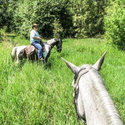 ERIK KAHN leads a guided trail ride at Bar UK River Ranch