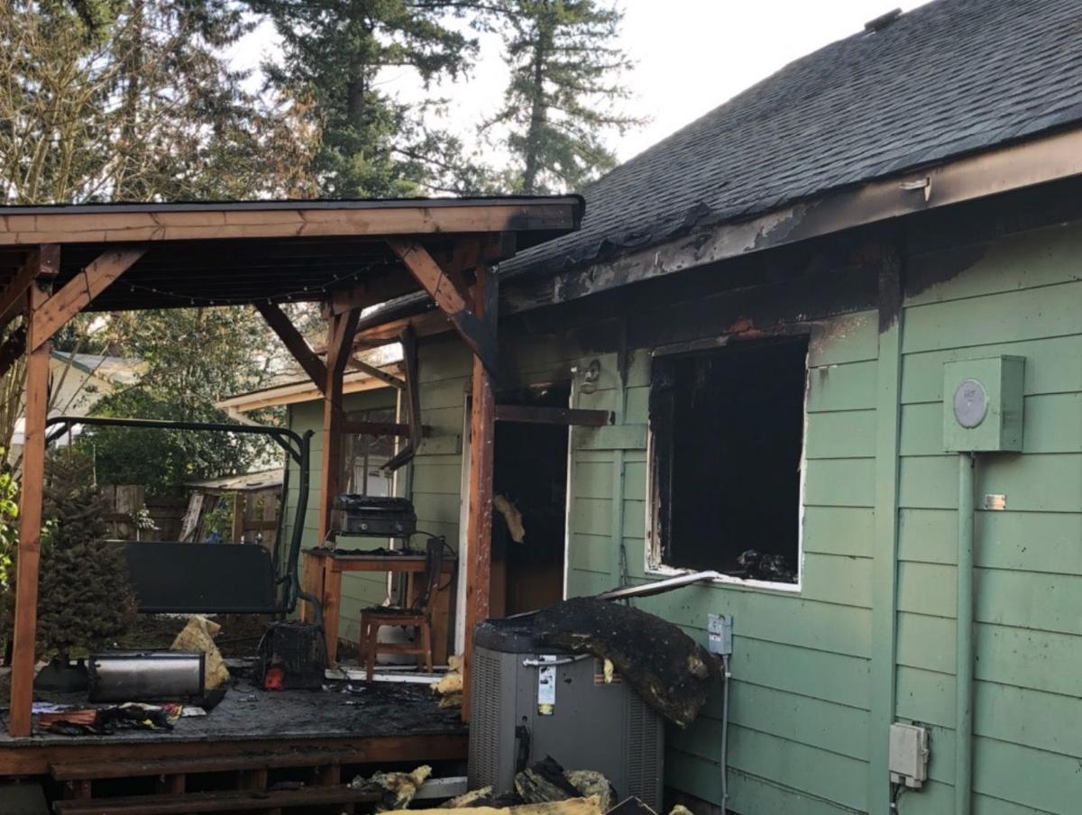 Vancouver firefighters rescue dog from burning home