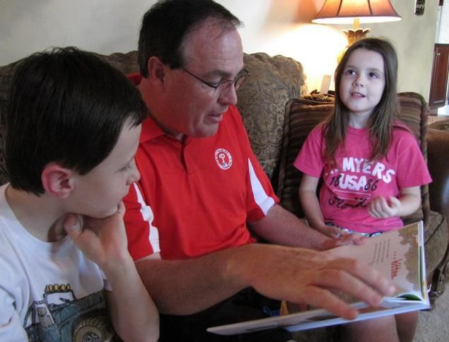 Father touched by opportunity to read to son's Walton Farm class