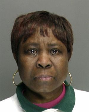 Aide charged in scalding death