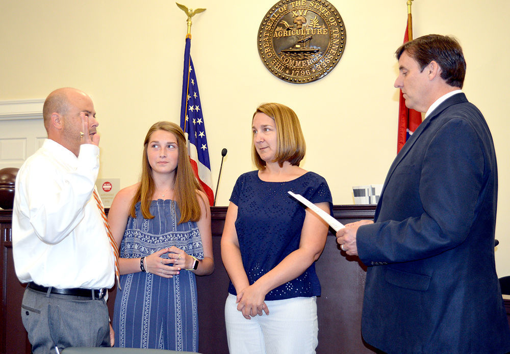 Brent Price takes the oath of office