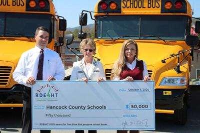 Holding the big check, left to right, are HCS Transportation Supervisor Joseph Southern, Director of Schools Charlotte Mullins, and CTE Director and Grant Writer Jennifer Yount.
