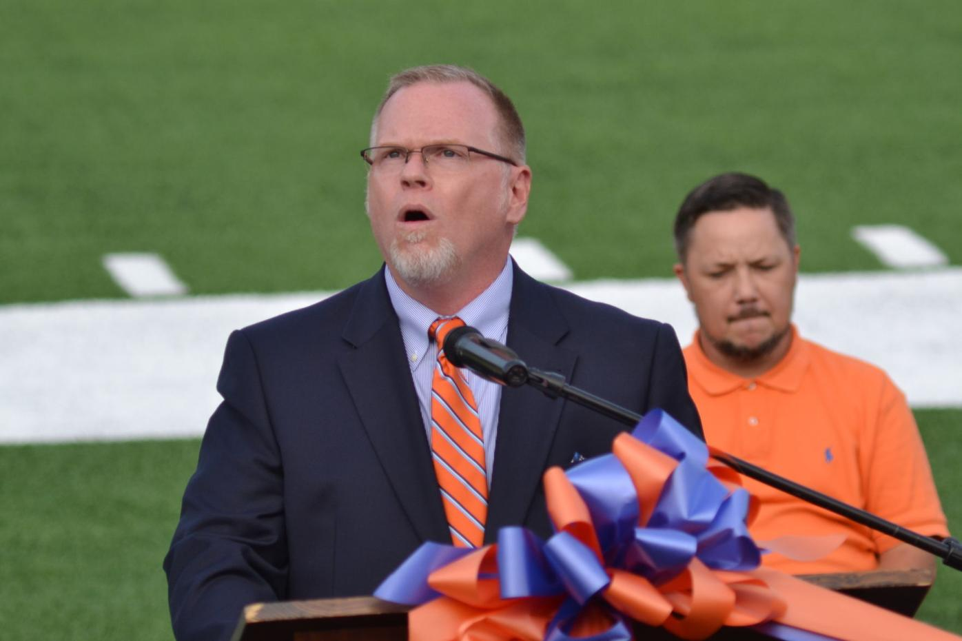 Volunteer officials celebrate new turf field with ribbon cutting