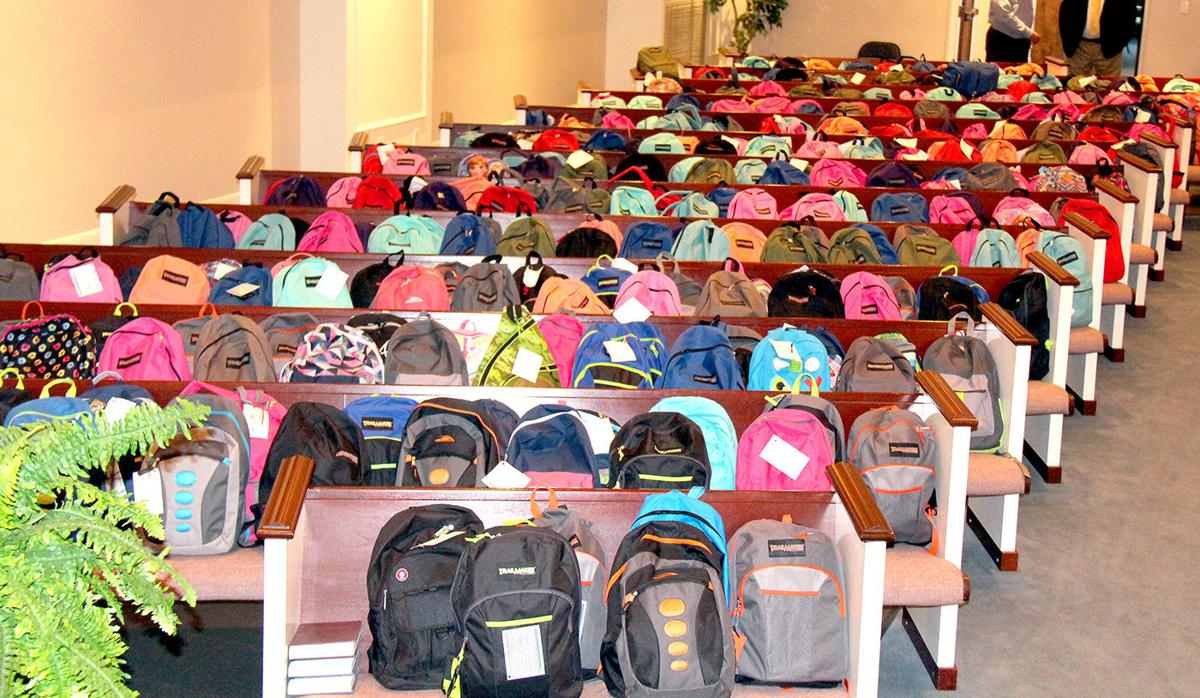 Backpacks by the hundreds!