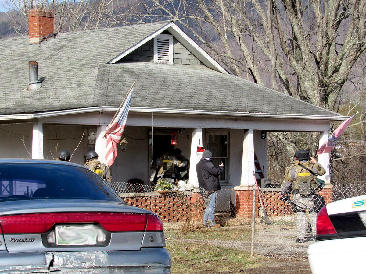Household taken into custody after search warrant turns up