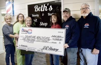 Local Heating and Cooling donates to barber/beauty shop renovation
