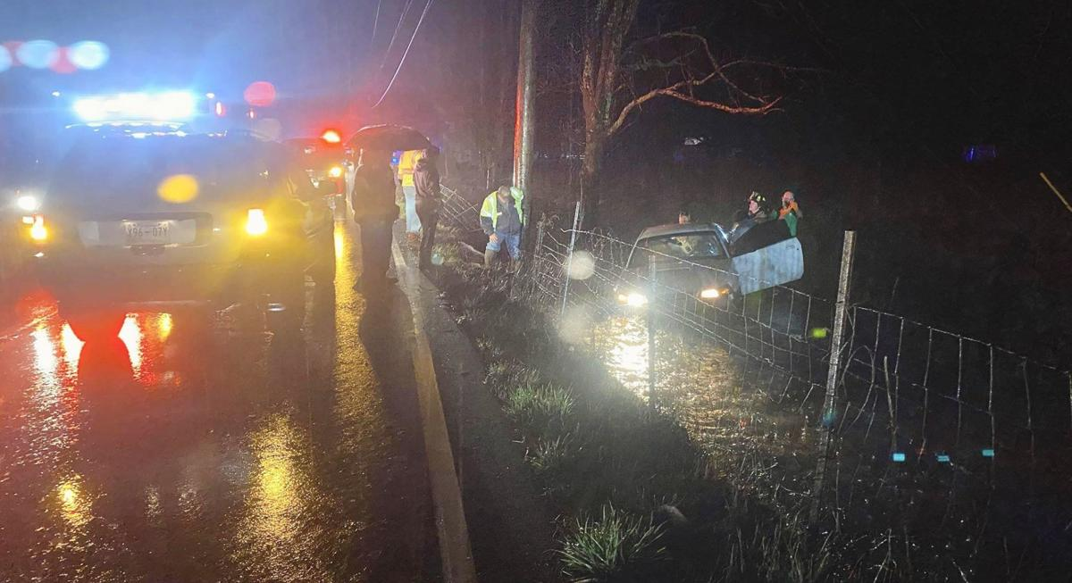 One sent to hospital after car lands in flooded ditch