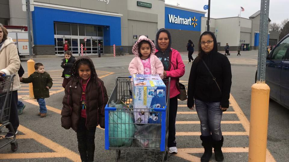 Family gifted with Christmas shopping from Shop With a Hero