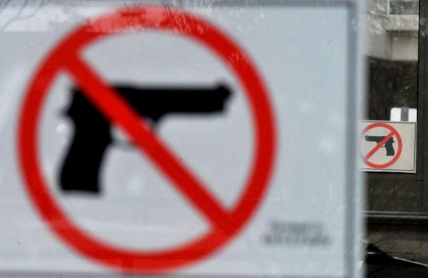 022014-nws-gunsigns