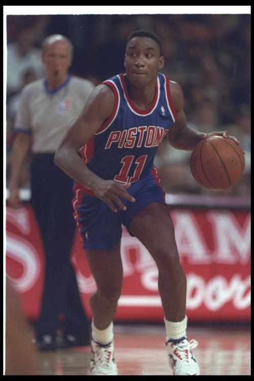 Detroit Pistons guard Isiah Thomas (11) moves the ball during a game against the Chicago Bulls at the United Center in Chicago on April 20, 1993.