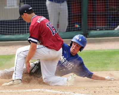 Steeleville's Owen Gross slides into the plate