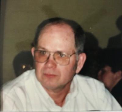 ELMER M. BROOKINS