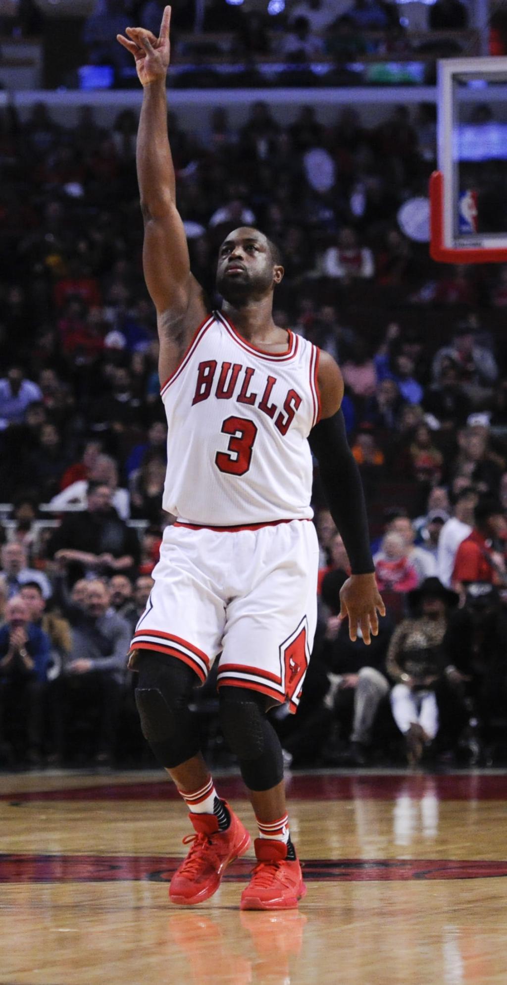 57dc316e75b Celtics Bulls Basketball. Chicago Bulls guard Dwyane Wade gestures after  scoring his first basket during ...