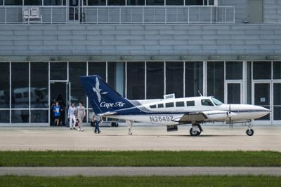 Passengers prepare to board a Cape Air flight