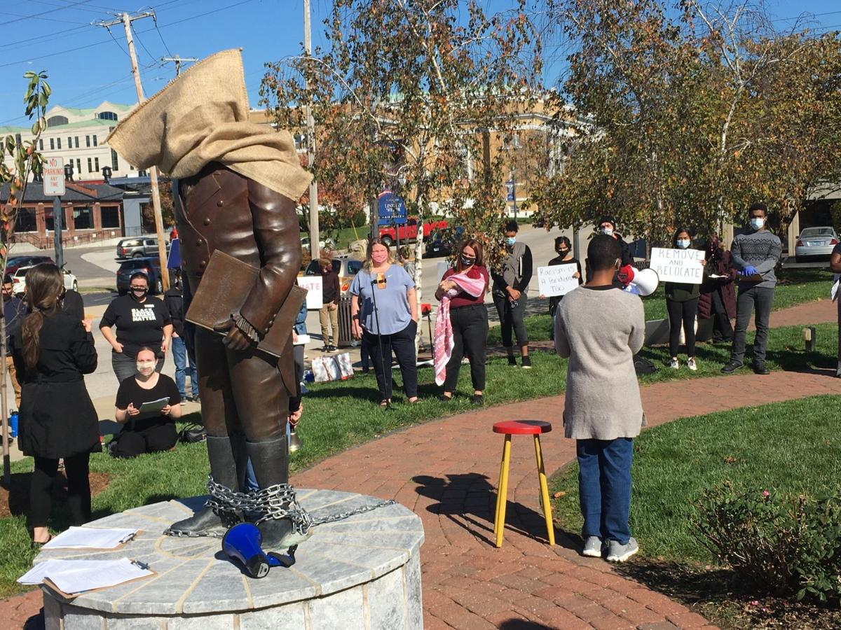 Protesters call for the removal of the Ninian Edwards statue in Edwardsville