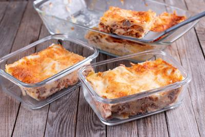 Semi-finished products. Lasagne or casserole in a container. Ready meals