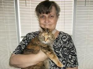 A resident and her cat. Liberty Village allows pets up to 20 lbs in weight!