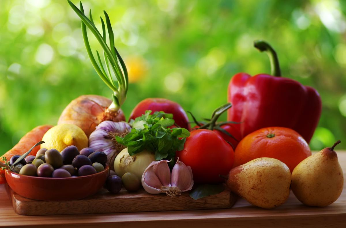 Ingredients for a mediterranean diet on green background close-up