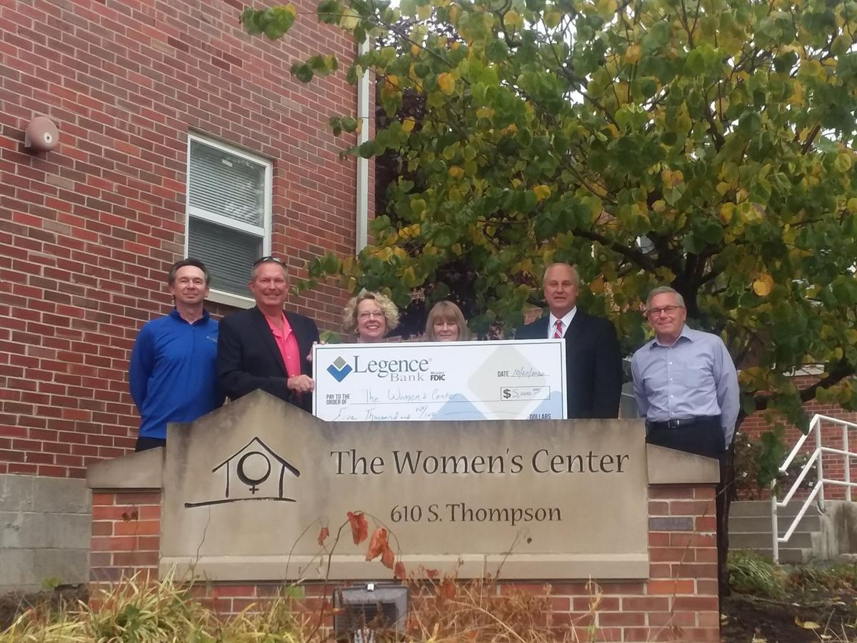 Check is presented to the Women's Center in Carbondale