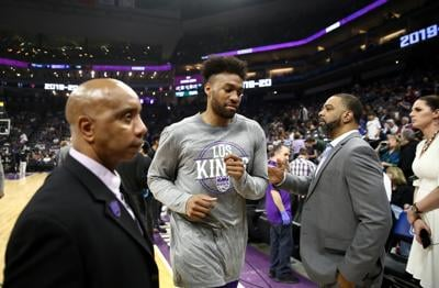 The Sacramento Kings' Jabari Parker, middle, leaves the court after a game against the New Orleans Pelicans was postponed due to the coronavirus at Golden 1 Center in Sacramento, California, on March 11, 2020.