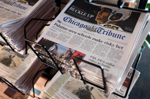 Tribune adopts shareholder rights plan to fend off Gannett