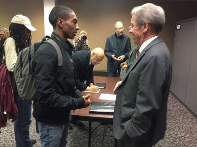Dorsey speaks with student government leader