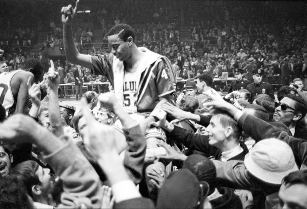 SIUs Walt Frazier Holds Up His Finger To Signal No 1 As He Is Hoisted Onto Shoulders Of Fans After Team Defeated Marquette 71 56 Win The National