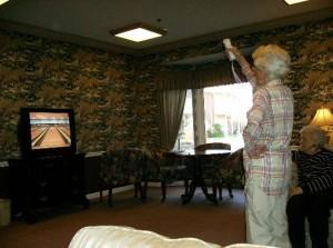 A resident enjoys Wii bowling