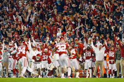 Oklahoma celebrates after the defense stopped the Texas Christian offense on fourth down in the fourth quarter on November 23, 2019, at Gaylord Family Oklahoma Memorial Stadium in Norman, Oklahoma.