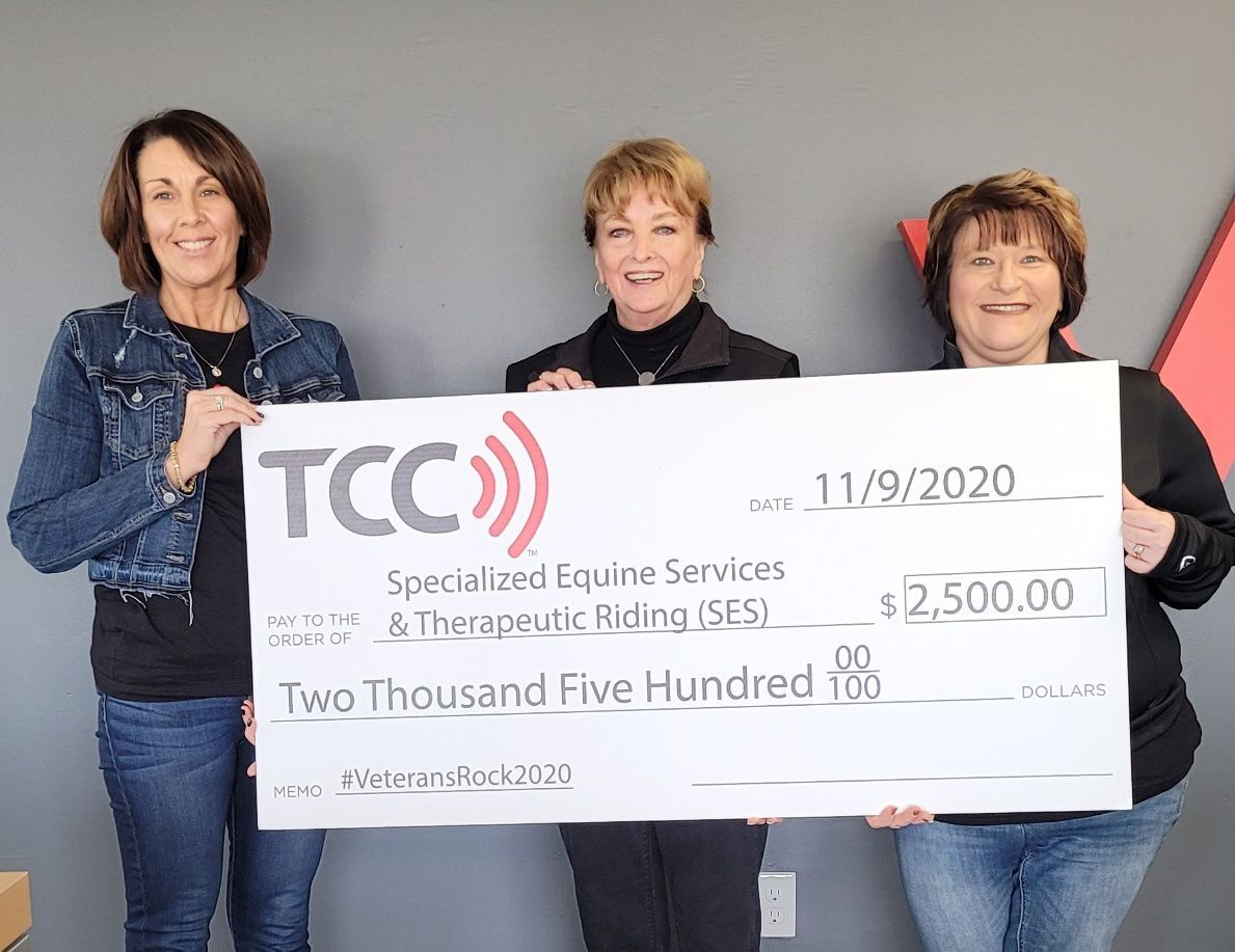 Check is presented to Specialized Equine Services Co-founder by TCC Verizon representative
