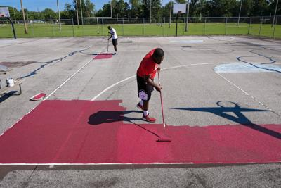 Painting the courts at Attucks Park