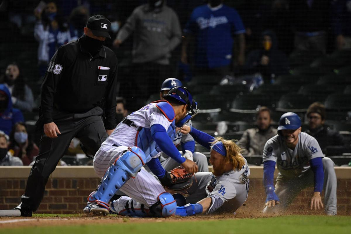 Justin Turner #10 of the Los Angeles Dodgers is tagged out in the 10th inning by Willson Contreras #40 of the Chicago Cubs at Wrigley Field on May 05, 2021 in Chicago, Illinois.