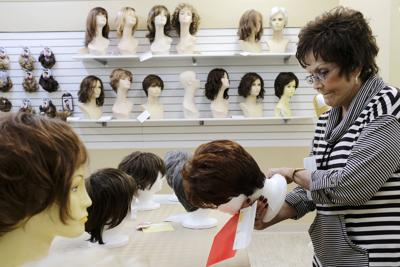 a4238c06 Mary McNail looks at her options at Sue's II, a women's boutique and wig  shop in Benton. McNail said she is wanting a wig to wear from time-to-time  because ...