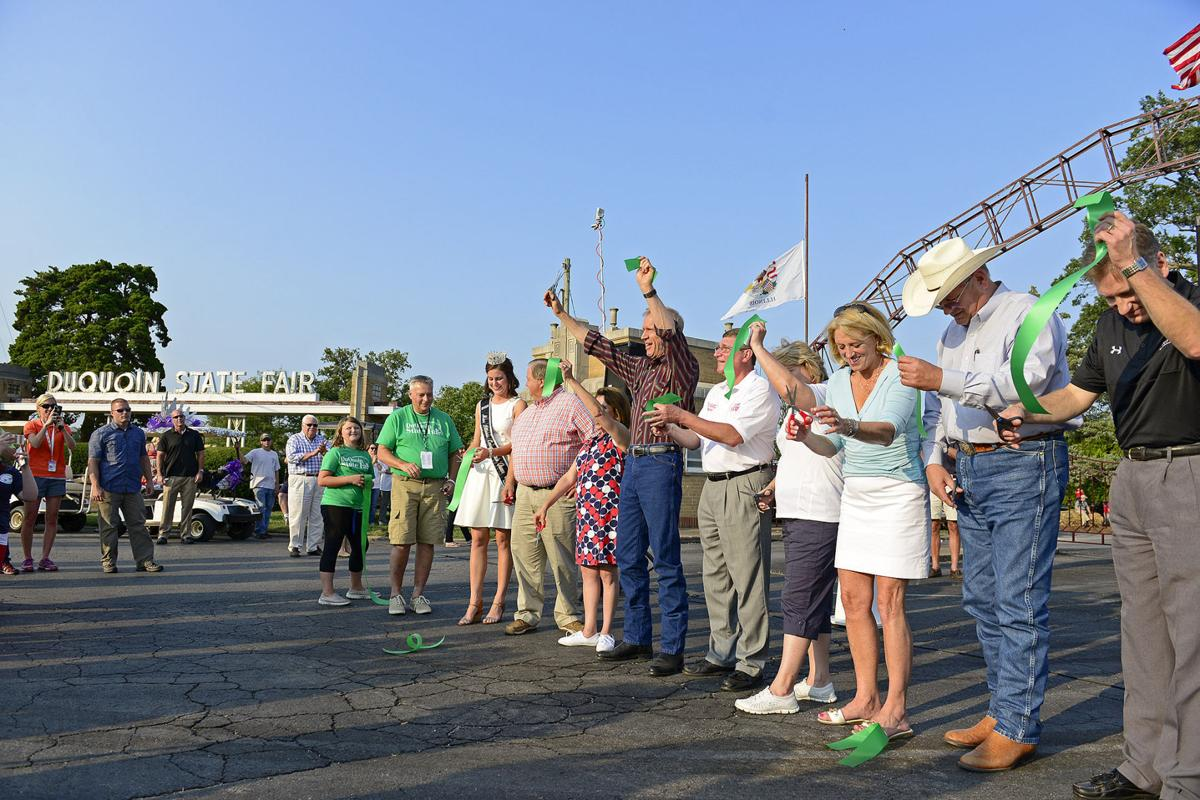Gov. Bruce Rauner and others cut ribbon to open 2015 Du Quoin State Fair