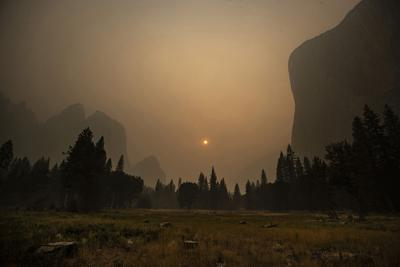 Thick smoke from multiple forest fires shrouds iconic El Capitan, right, and the granite walls of Yosemite Valley on Sept. 12, 2020, in Yosemite National Park, California.