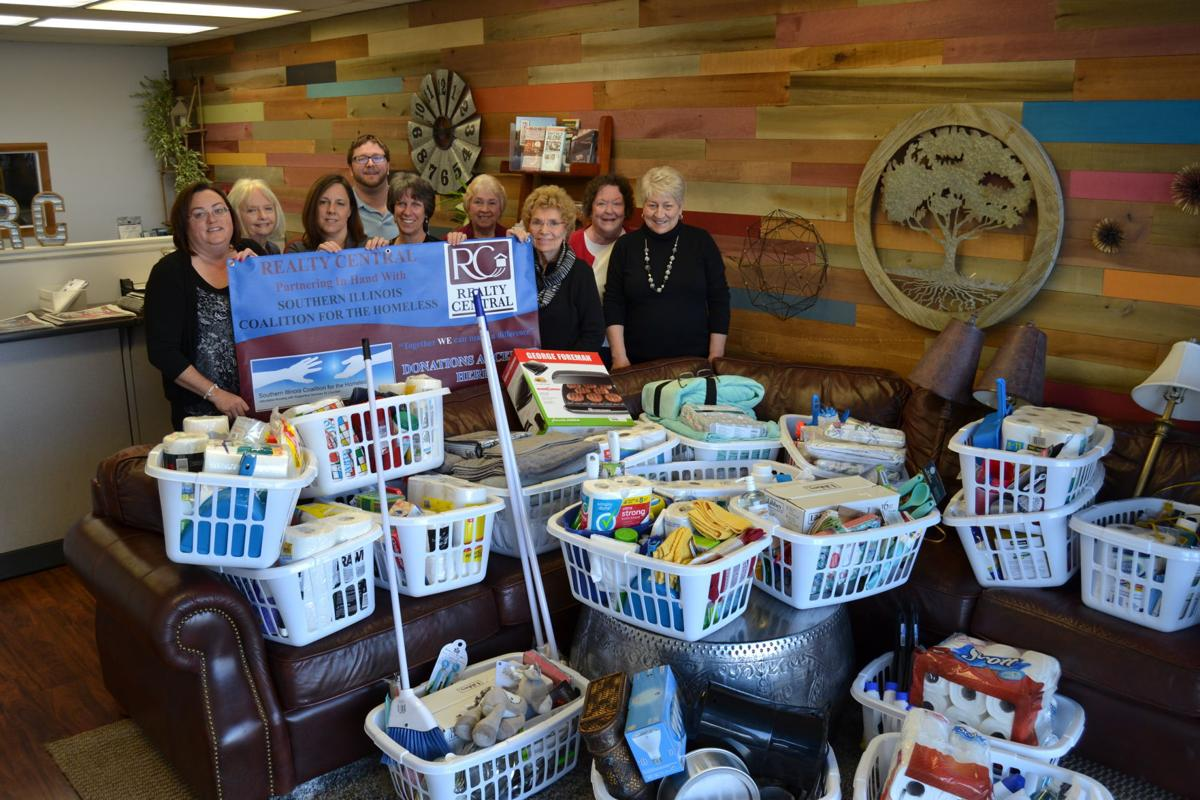Realty Central agents with 'welcome home' baskets