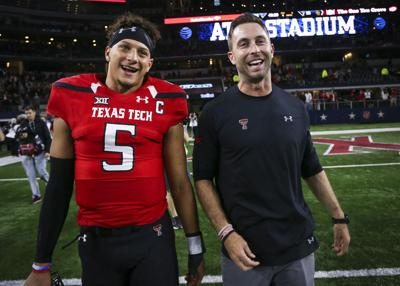 Texas Tech quarterback Patrick Mahomes II (5) and head coach Kliff Kingsbury walk off the field after after a 54-35 win against Baylor at AT&T Stadium in Arlington, Texas, on Nov. 25, 2016.