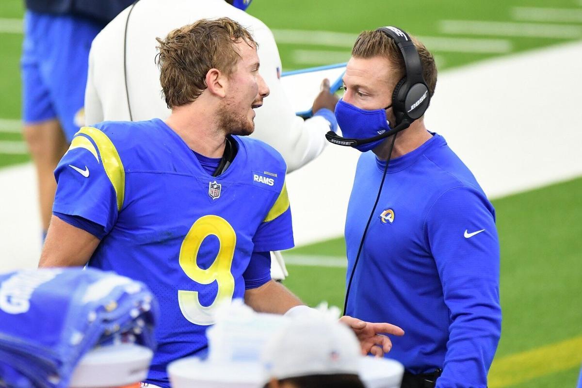 Los Angeles Rams quarterback John Wolford talks with head coach Sean McVay on the sideline at SoFi Stadium in Inglewood, Calif., on Jan. 3, 2021..
