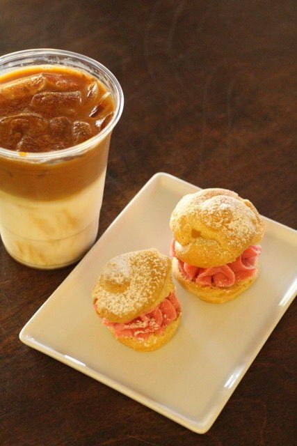 Coliseum Iced Honey Cinnamon Latte and Keepers Quarters Rasberry Cream Puffs.jpeg