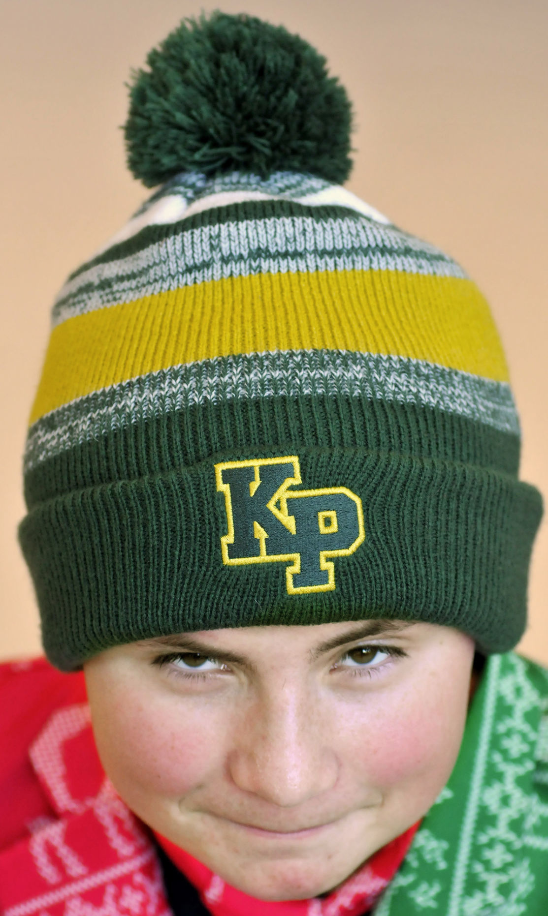 c58a67738ad King Philip student sells hats for a good cause