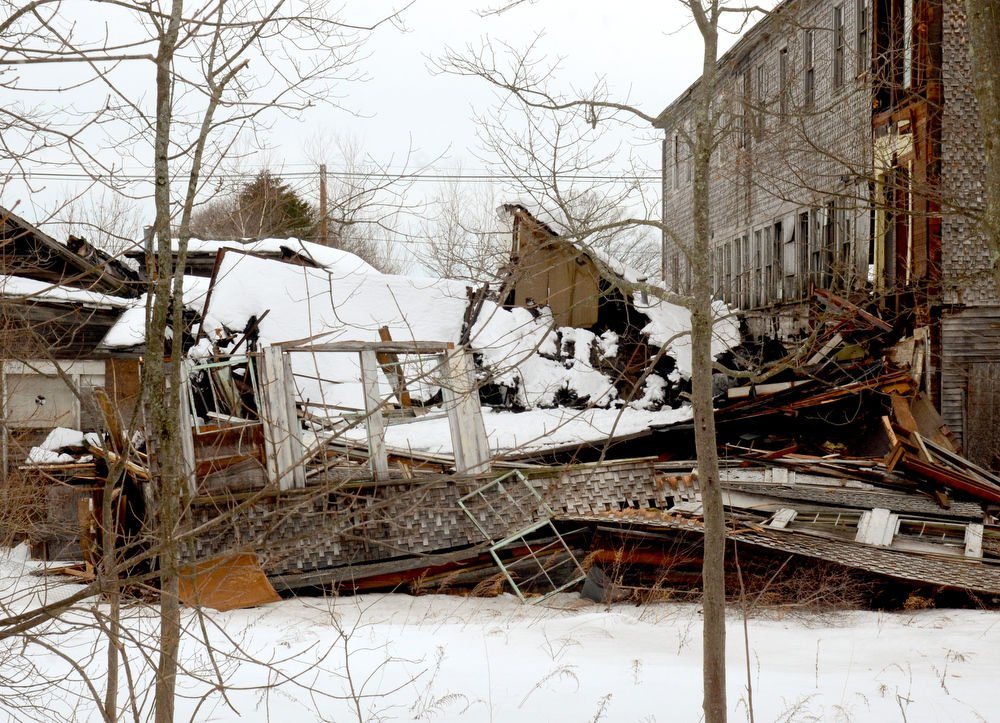 Part of the Webster building collapses