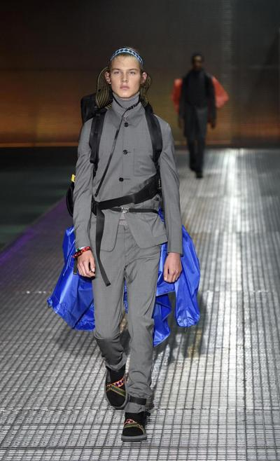 A model wears a creation for Prada men s Spring-Summer 2016-2017  collection facaeb25f89