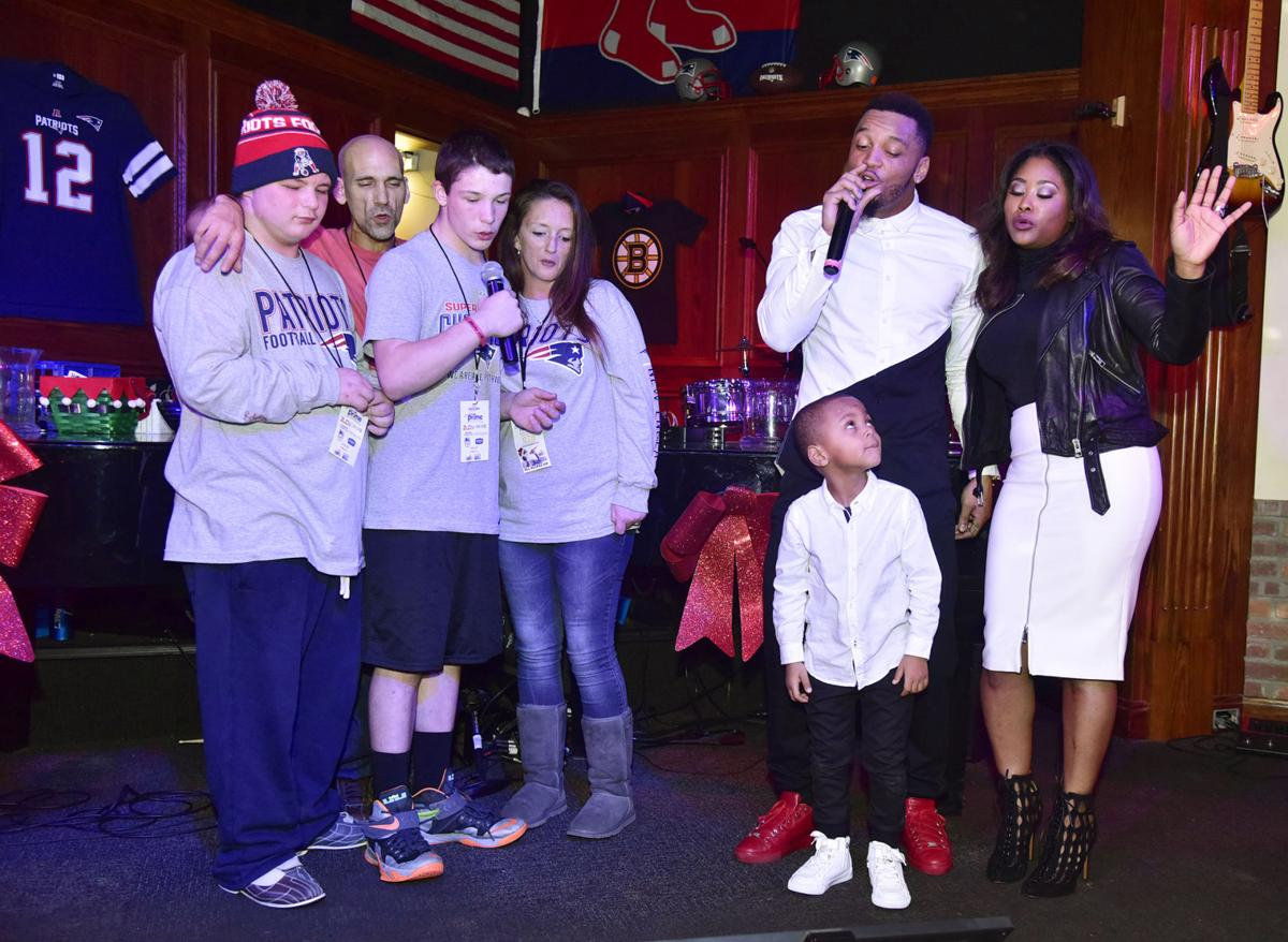 Patriots turn out to sing for Patrick Chung fundraiser for kids