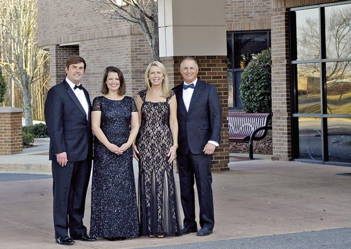 Todd and Monica McElhone, left, and Russ and Leslie Fender