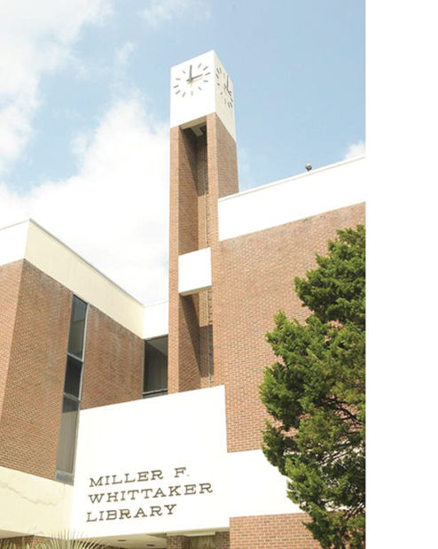 This is an image of the front-side view of the Miller F Whittaker Library. The image shows how the building looks from the outside and its surroundings.