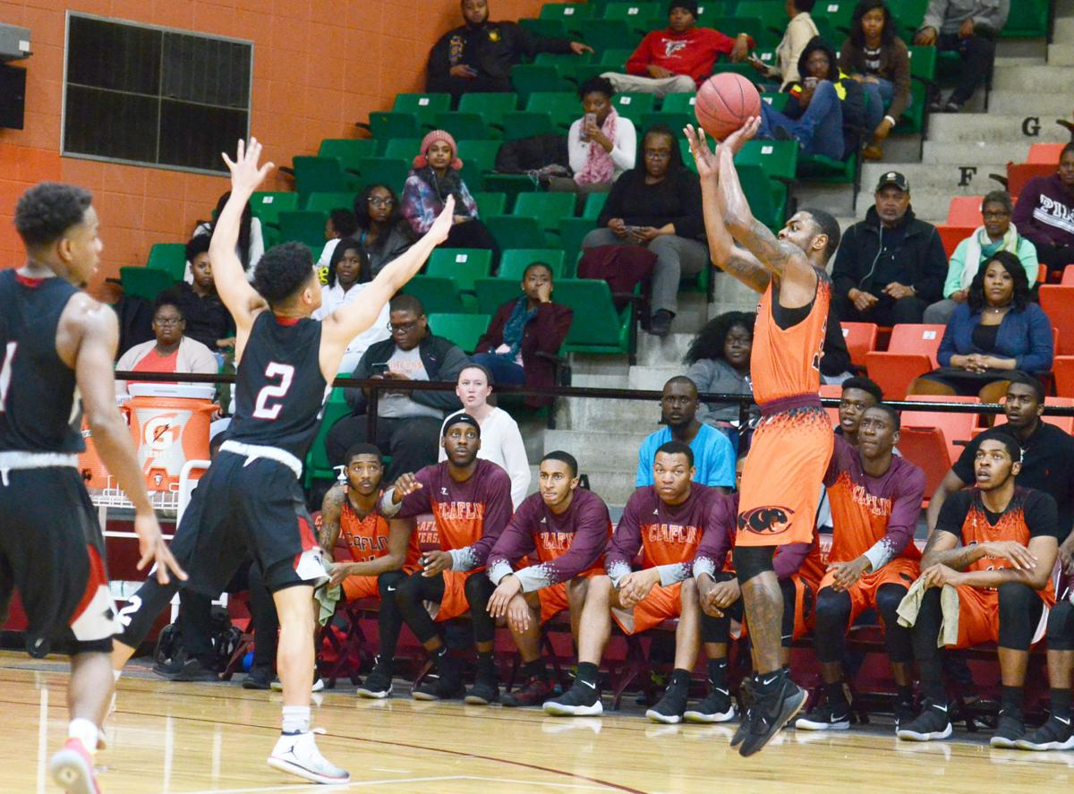 Claflin Johnson shoots 3-pointer