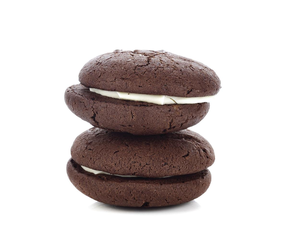 Chocolate whoopie pie on white background