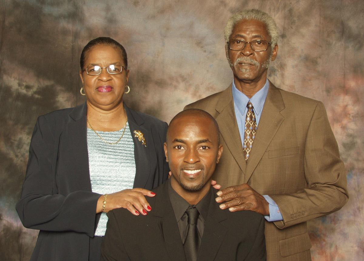 Dwayne Harper with his mother and father