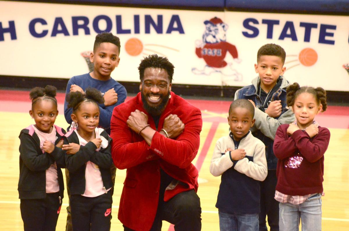 Travis Love with kids at S.C. State men's basketball game