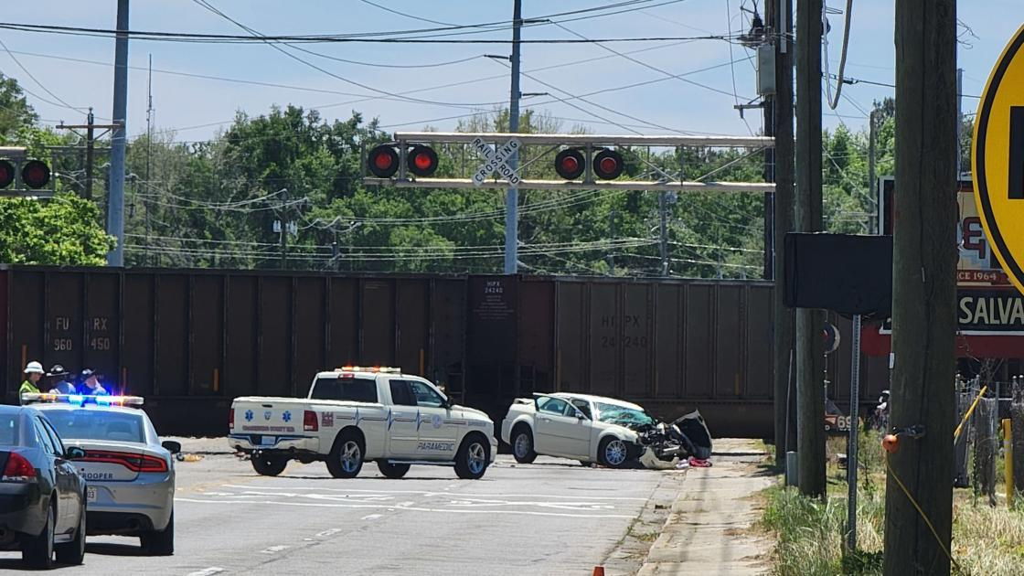One injured when train, car collide; driver airlifted to hospital